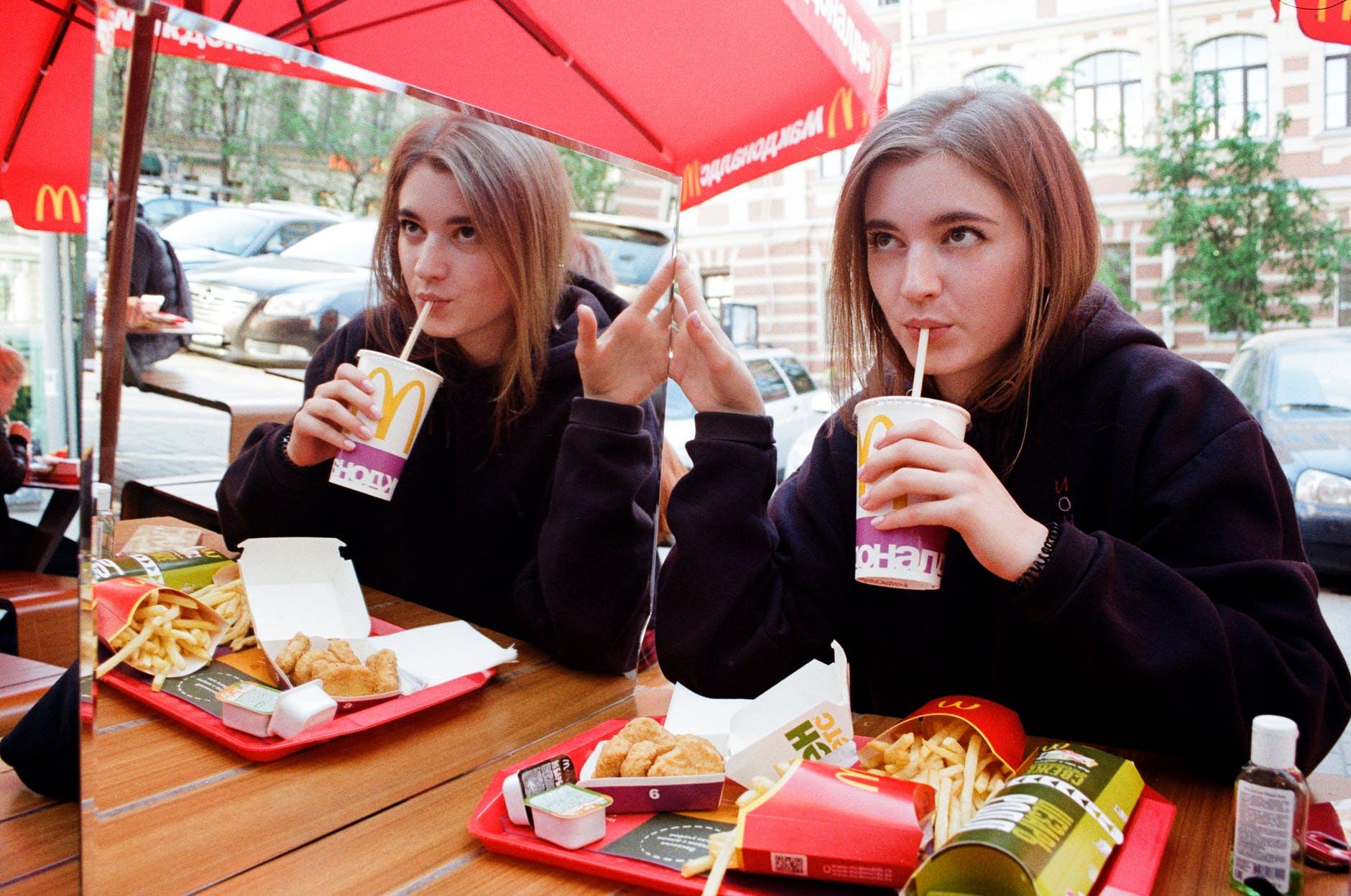 Girl eating in Mcdonalds