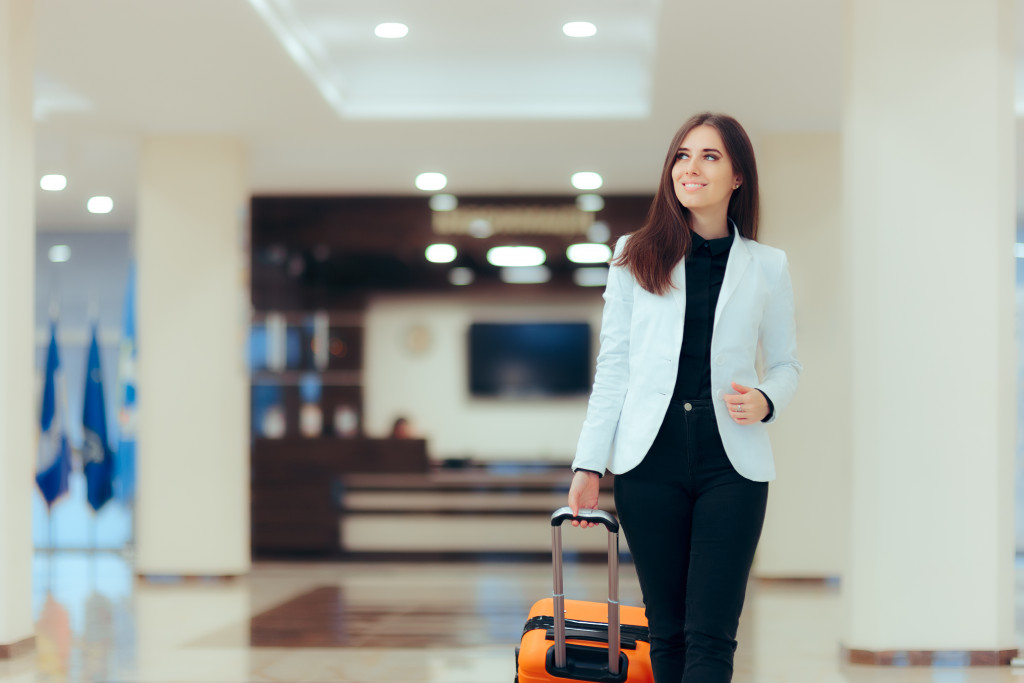 woman carrying luggage